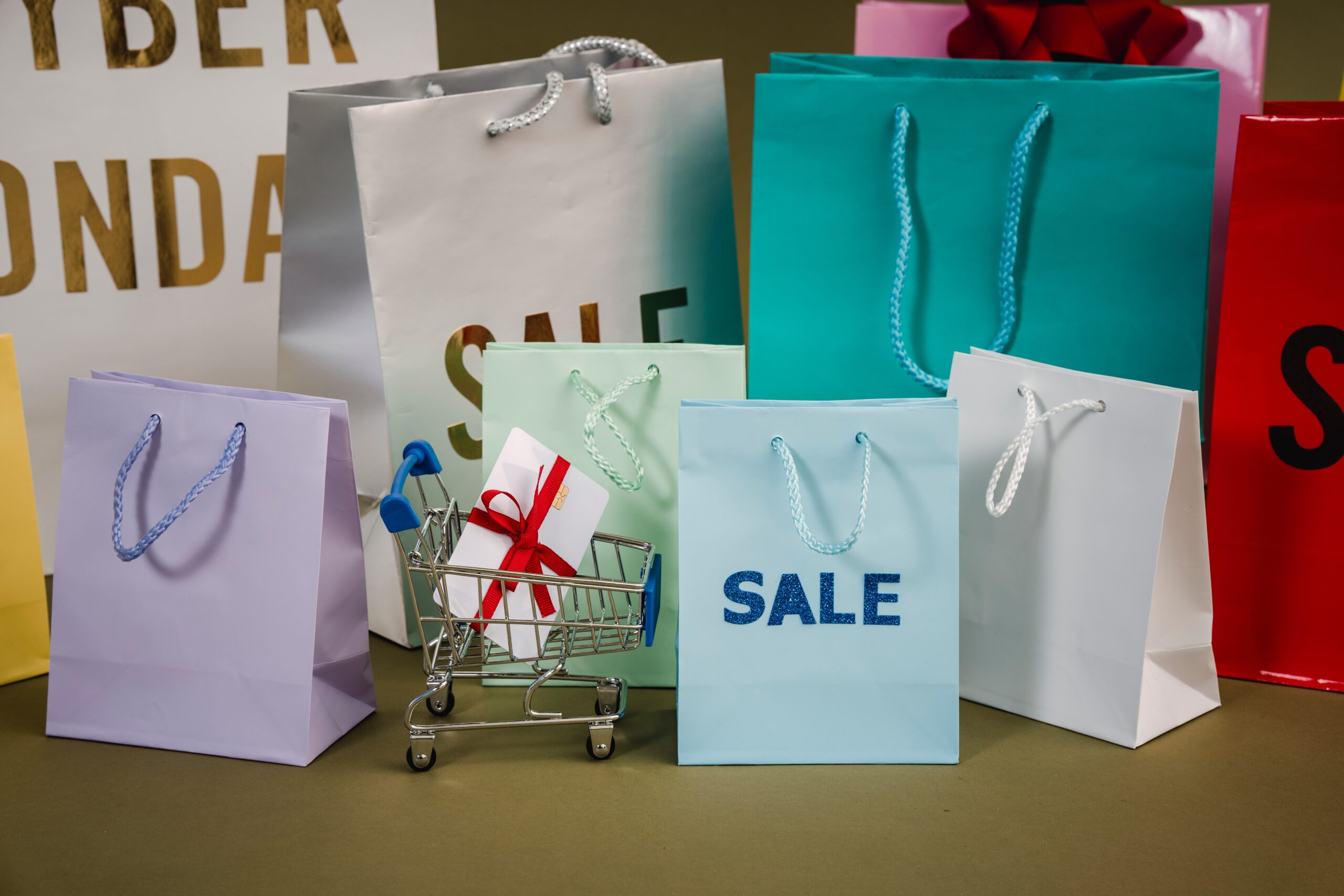 Shopping bags with sale written on them